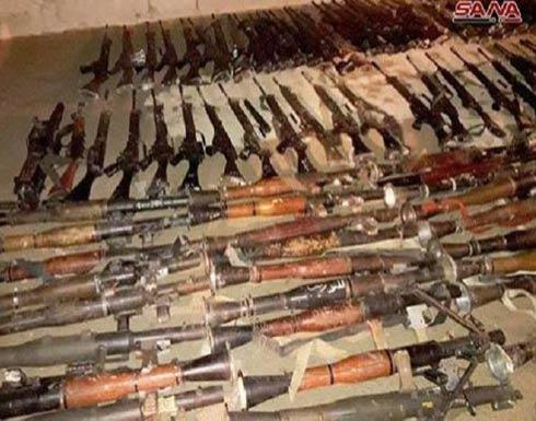 """تسليم مسلحي """"جيش الإسلام"""" 400 قطعة سلاح عند خروجهم من دوما"""