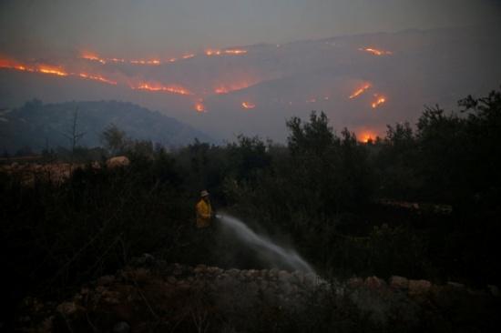 13 حقيقة عن النيران التي التهمت إسرائيل