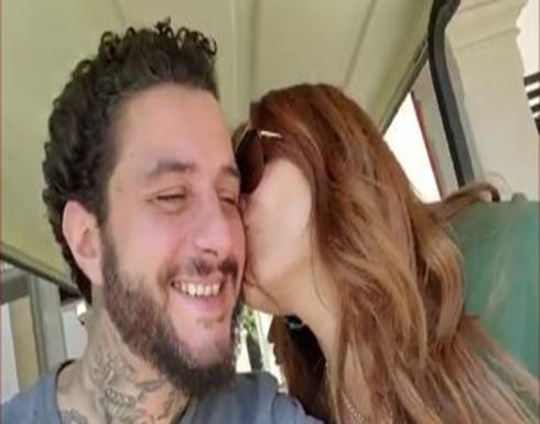 """أحمد الفيشاوي وزوجته ندى الكامل يستغلان الاجازة بـ """"القبلات"""" .. بالفيديو"""