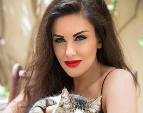 شاهد :  الاردنية دانا حمدان تتالق بالاحمر المكشوف