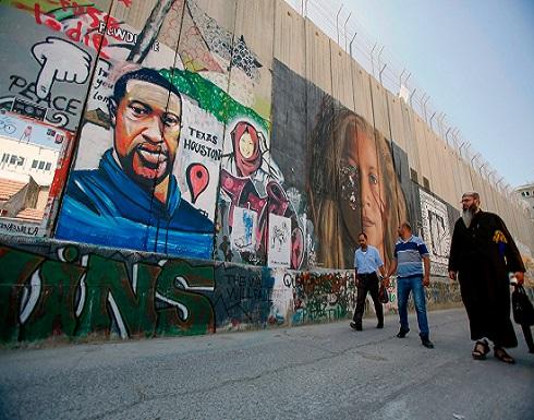 """رسم للأمريكي """"فلويد"""" على الجدار الفاصل بالضفة الغربية"""