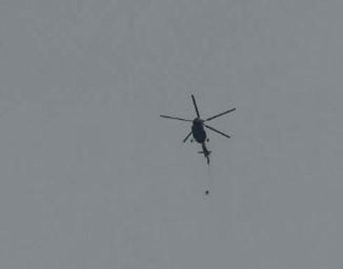بالفيديو : مظلي يعلق بذيل مروحية أثناء تحليقها