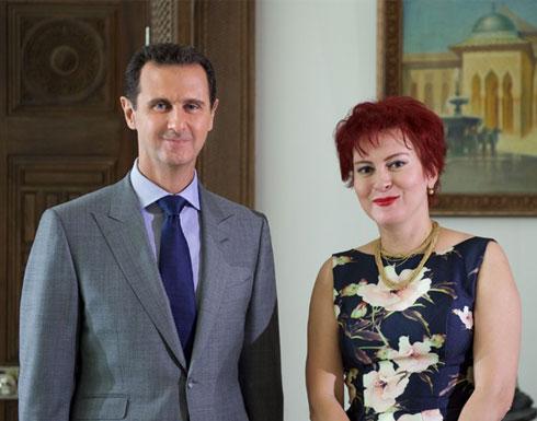 فضيحة.. الروسية التي قابلت الأسد نجمة إباحية (صور)