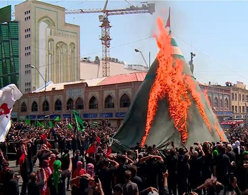 شاهد :المئات يحيون ذكرى عاشوراء في طهران