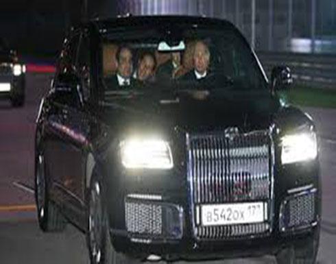 شاهد : السيسي يركب سيارة بوتين الجديدة على حلبة فورمولا