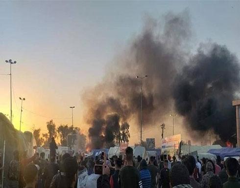 بالفيديو : أنصار مقتدى الصدر يهاجمون المتظاهرين في النجف