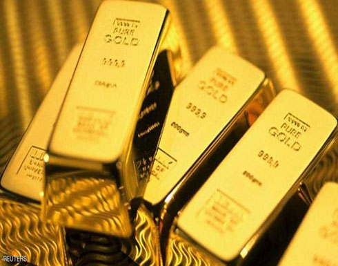 الذهب ينزل من ذروة شهر مع ارتفاع الدولار