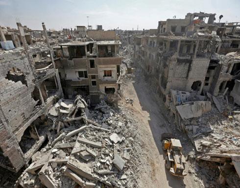 إزالة الأنقاض من شوارع مخيم اليرموك في دمشق بانتظار إعادة الإعمار