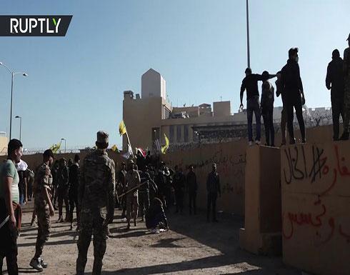 شاهد : اقتحام السفارة الأمريكية في بغداد واصابة  62 جريحا بين المحتجين