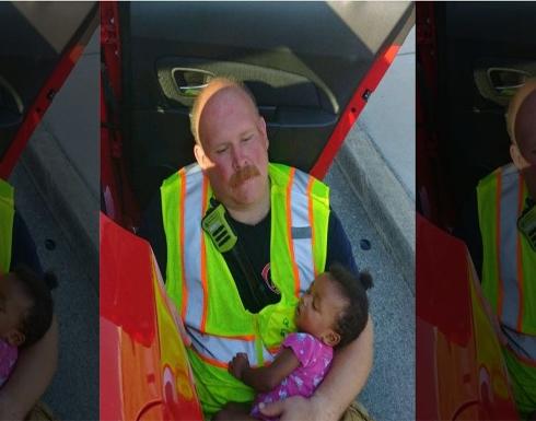 صورة تدمي القلوب.. رجل إطفاء يحتضن طفلة بعد حادث سير!