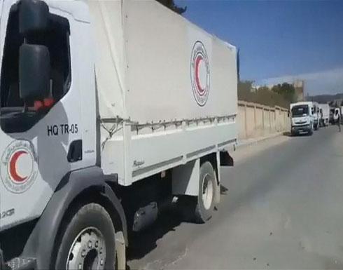 قافلة مساعدات تدخل الغوطة.. وغارات جوية على دوما