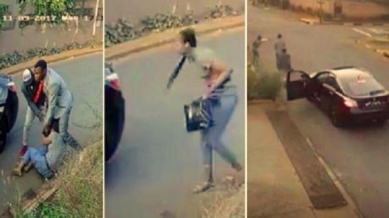 شاهد ... الطالبة تعاند لصين في الشارع ورأسها مهدد بمسدس