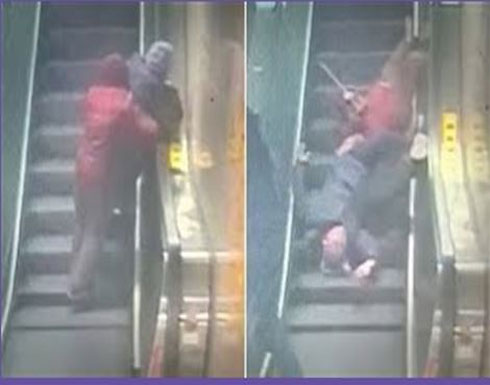 رجل ينقذ حياة زوجين مسنين على سلم كهربائي (فيديو)