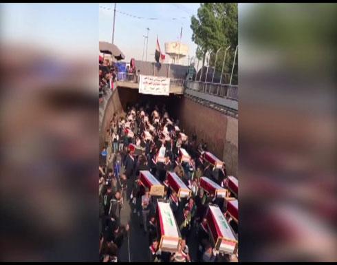شاهد : العراق يودع شهداء المظاهرات بجنازة حاشدة