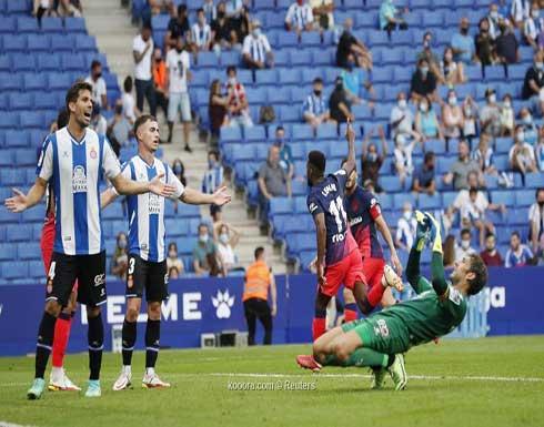 بالصور: ليمار يمنح أتلتيكو الفوز على إسبانيول بالدقيقة 99