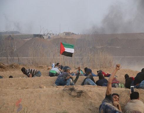 """عشرات الإصابات بغزة بجمعة """"شعبنا سيسقط الوعد المشؤوم"""""""