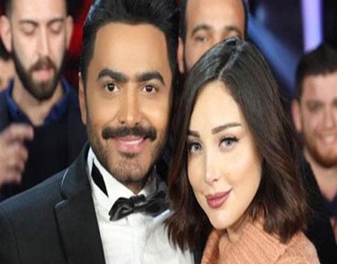 زوجة تامر حسني بفستان وقوام رشيق تبرز أنوثتها .. شاهد
