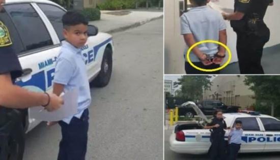 """فيديو.. توقيف طفل """"بعمر 7 سنوات"""" مقيد اليدين عقب ضرب معلمته بأمريكا"""