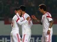 لاعبو الصين يحتفلون بالفوز